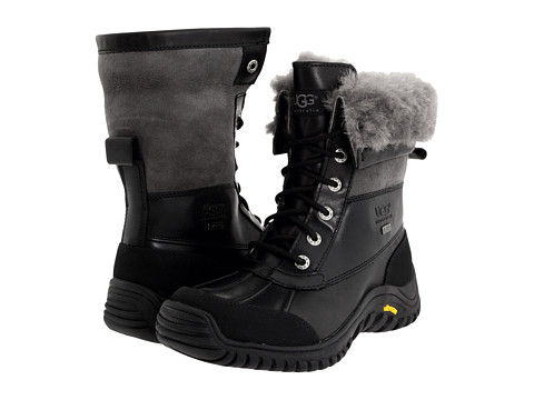 Shop UGG online and buy UGG Adirondack Boot II Black/Grey Shoes - UGG - Adirondack Boot II (Black/Grey) - Footwear: The Adirondack II is a premium cold weather boot. The leather and sheepskin upper combine to provide you with protection while the genuine sheepskin and eVent lining inside give you comfort and warmth. ; Full-grain leather upper features a waterproof and windproof eVent membrane that vents moisture from inside the shoe for a durably waterproof boot. ; Genuine sheepskin lining above the ankle and around the shaft provide cozy comfort and warmth. ; eVent fabric lining below the ankle and around the foot portion offers waterproof benefits to keep your feet dry. ; eVent Fabric: Through Direct Venting proprietary and patented technology, millions of tiny pores are able to breathe at their full potential, allowing sweat to vent directly to the outside of the fabric in one easy step. ; Cushioned insole can be removed and washed to extend the life and freshness of the footbed. ; Exclusive Vibram outsole designed specifically for UGG Australia utilizing the TCI wet/snow compound. ; Outsole is seam sealed to keep moisture out. ; Please note: Slight dye transfer may occur with darker colored sheepskin during first few wears. Measurements: ; Heel Height: 1 in ; Weight: 1 lb 7 oz ; Circumference: 12 1 2 in ; Shaft: 7 in ; Product measurements were taken using size 7, width B - Medium. Please note that measurements may vary by size.