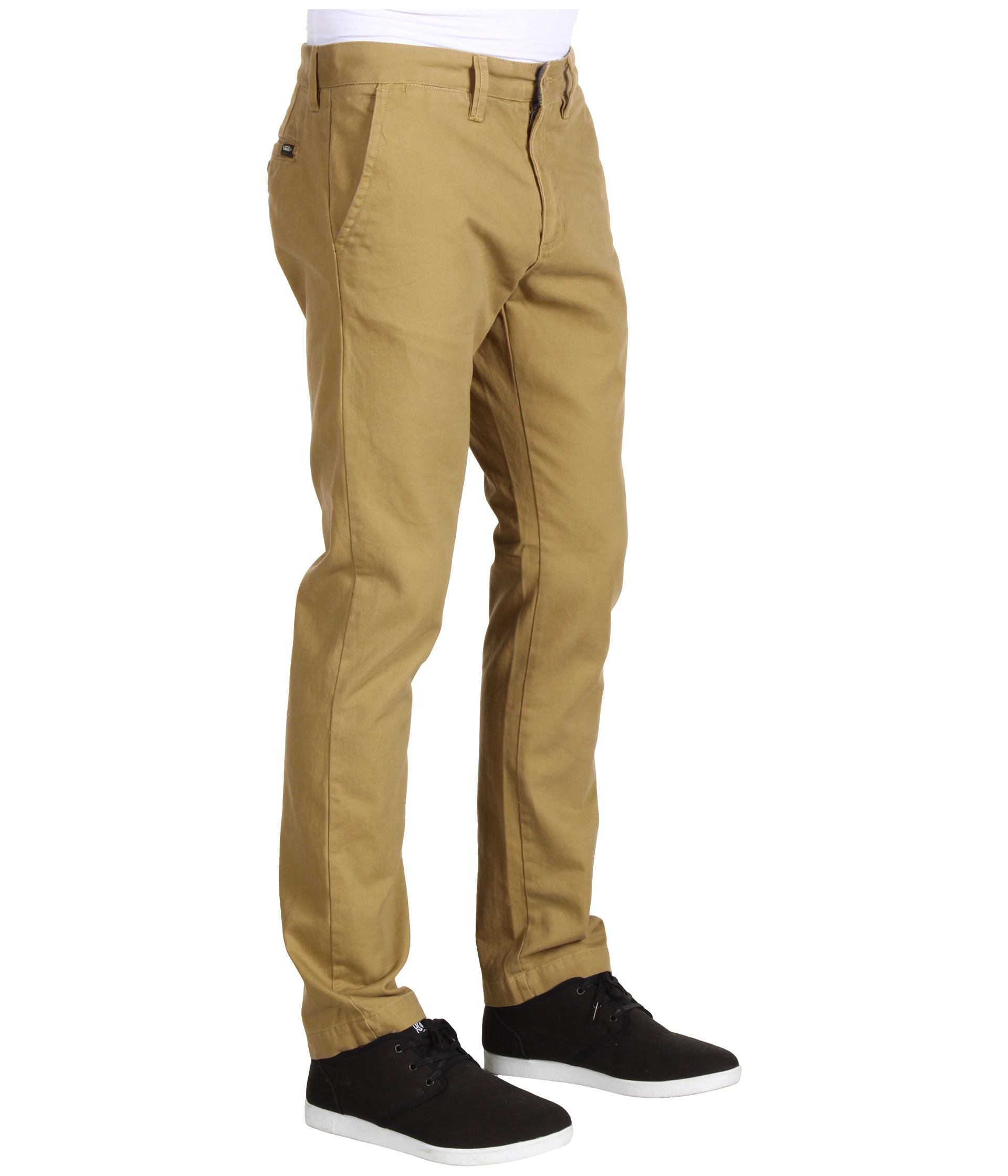 An excellent place to start is with a high-quality pair of black chino pants. You can pair black chino pants with anything, from your favorite graphic tees to your best button up shirt. If black chino pants are too boring for you, try a pair of printed chino pants.