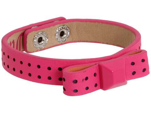 Look tough and pretty all at once with the Juicy Couture® Bow Leather Stud ...