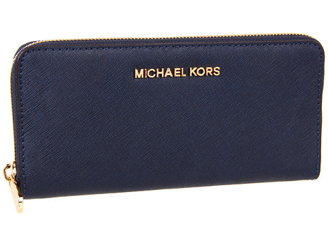 40f6a2d967c2 Ideal for every jet-setting woman, this sophisticated wallet makes a chic  statement.