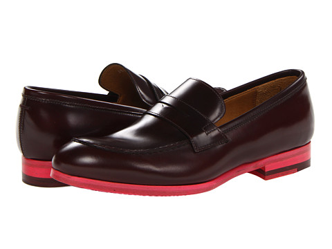 Shop Paul Smith online and buy Paul Smith Men Only Gattopardo Penny Loafer Wine Shoes - Paul Smith - Men Only Gattopardo Penny Loafer (Wine) - Footwear: A class act! Create a role to be remembered wearing the Paul Smith Men Only™ Gattopardo Penny Loafer. ; Leather upper. ; Notched strap across the vamp. ; Leather lining. ; Floral decorated footbed. ; Leather insole. ; Colorful synthetic outsole. ; Made in Italy. ; The Men Only collection is a reflection of the men's mainline collection and is convincingly Paul Smith, with meticulous detail, craftsmanship and authenticity conveyed in every shoe, brogue and boot. Measurements: ; Heel Height: 3 4 in ; Weight: 11 oz ; Product measurements were taken using size 38 (US 8), width M. Please note that measurements may vary by size.