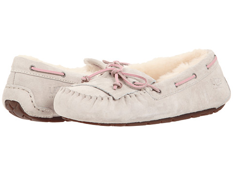 Shop UGG online and buy UGG Mandie Cloud Shoes - UGG - Mandie (Cloud) - Footwear: Your feet will thank you once you slip on the UGG Australia Mandie slipper. ; Soft suede upper with leather lace and stitch bow detailing for much added appeal. ; Fully lined in luxurious, UGGpure™ wool. It′s a luxurious, natural wool woven into a durable backing that enhances the overall product experience. UGGpure delivers a plush sensory experience with every wear. ; Generously cushioned footbed massages the foot with each and every step. ; Gum rubber outsole delivers long-lasting durability on a variety of surfaces. ; Please Note: Slight dye transfer may occur with darker colored sheepskin during first few wears. ; Imported. Measurements: ; Weight: 9 oz ; Product measurements were taken using size 7, width B - Medium. Please note that measurements may vary by size.