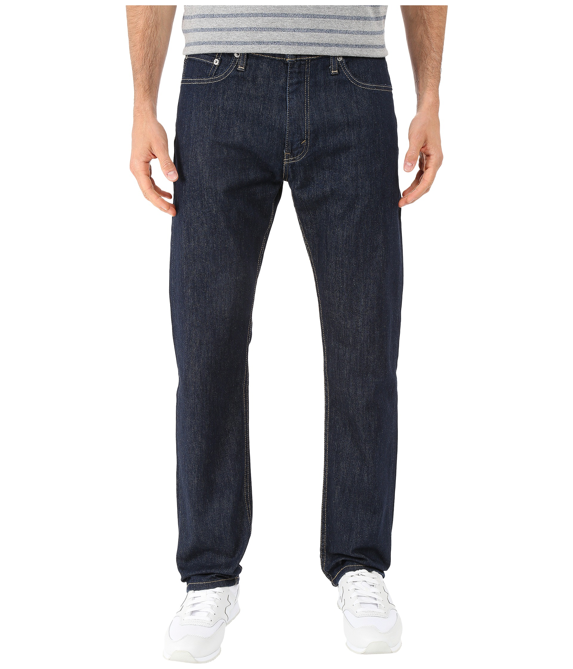 Keep it casual and cool all season in our slim-fit, straight-leg jeans from Arizona, featuring a hint of spandex for easy stretch. sits just below waist.