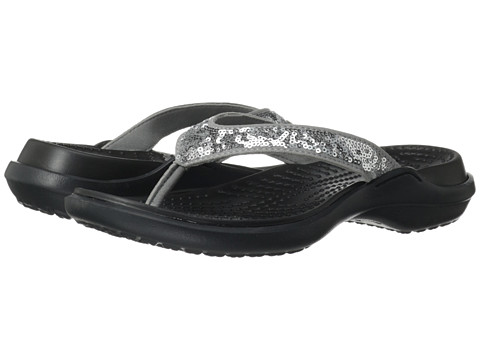 Shop Crocs online and buy Crocs Capri Sequin Sandal Silver-Black Shoes - Crocs Capri Sequin Sandal Silver/Black Footwear: Feel the sun at your toes in the sassy Crocs® Capri Sequin Sandal. ; Synthetic upper with sequin detailing for added flair. ; Slip-on for easy on-and-off wear. ; Synthetic lining. ; Croslite™ material footbed cushions and comforts. ; Croslite™ outsole for a pleasurable walking experience. ; Imported. Measurements: ; Heel Height: 1 1 2 in ; Weight: 4.4 oz ; Platform Height: 1 2 in ; Product measurements were taken using size 9, width M. Please note that measurements may vary by size.