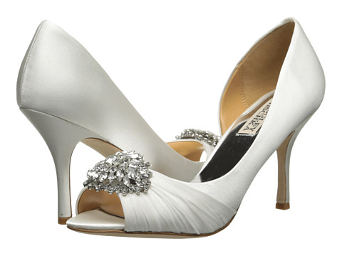 Shop Badgley Mischka online and buy Badgley Mischka Pearson White Satin Shoes - Badgley Mischka - Pearson (White Satin) - Footwear: You'll be unforgettable when you step out in these stunning pumps! ; Easy slip-on wear. ; Sleek satin upper with sparkling stone detail at vamp. ; Leather lining. ; Lightly cushioned leather footbed. ; Wrapped heel. ; Leather sole. ; Imported. Measurements: ; Heel Height: 3 1 4 in ; Weight: 7 oz ; Product measurements were taken using size 5.5, width M. Please note that measurements may vary by size.