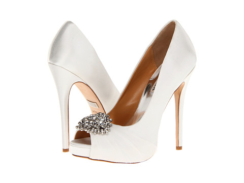 Shop Badgley Mischka online and buy Badgley Mischka Pettal White Satin Shoes - Badgley Mischka - Pettal (White Satin) - Footwear: These pretty pumps are the epitome of class and elegance! ; Easy slip-on wear. ; Rich satin upper with ruched fabric at vamp. ; Sparkling jewels add visual appeal. ; Open toe. ; Leather lining. ; Lightly cushioned leather footbed. ; Wrapped platformand heel. ; Leather sole. ; Imported. Measurements: ; Heel Height: 5 in ; Weight: 10 oz ; Platform Height: 3 4 in ; Product measurements were taken using size 5.5, width M. Please note that measurements may vary by size.