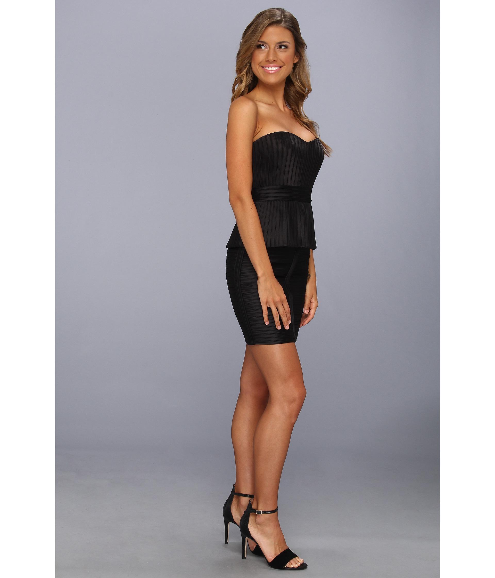 e0b1f3c8578b9 BCBGMAXAZRIA Karina Strapless Peplum Dress on PopScreen
