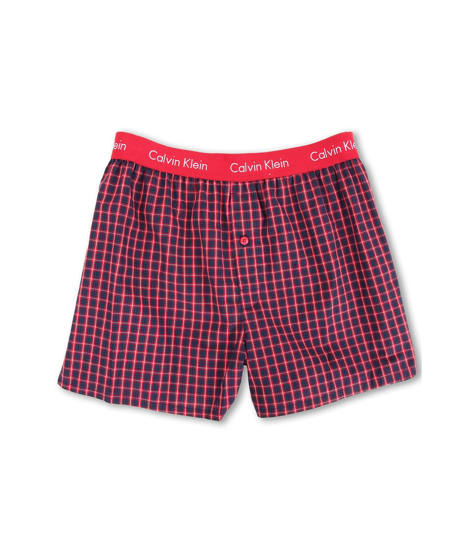 Calvin Klein™ presents a comfy woven boxer in a modern slim fit. Pre-washed woven cotton boxer boasts a slim fit and shorter length for wear under close-fit pants. Lower rise. Signature logo encircles the elastic waistband. One-button fly. Center back seam. Side slits. 100% cotton. Machine wash cold, tumble dry low. Imported $17.99