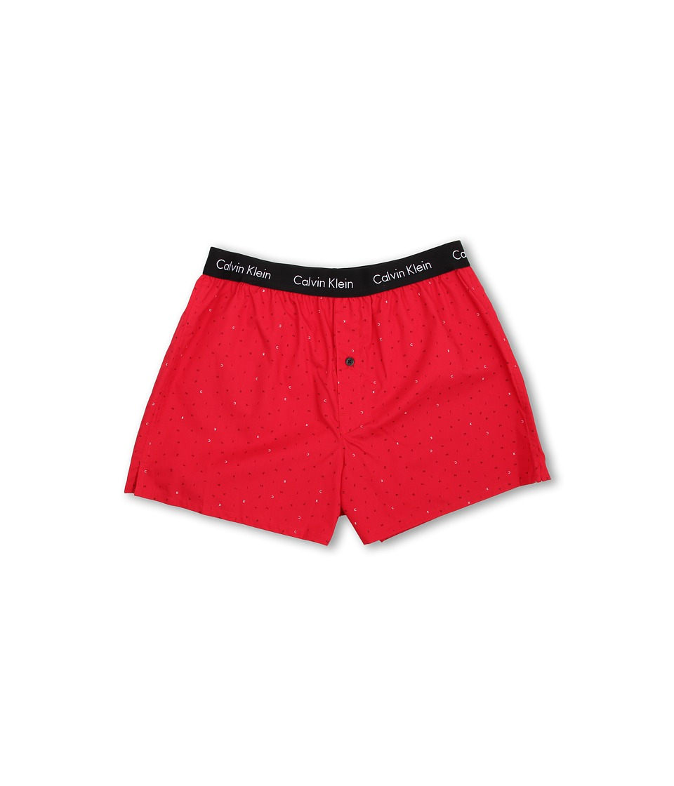 Calvin Klein™ presents a comfy woven boxer in a modern slim fit. Pre-washed woven cotton boxer boasts a slim fit and shorter length for wear under close-fit pants. Lower rise. Signature logo encircles the elastic waistband. One-button fly. Center back seam. Side slits. 100% cotton. Machine wash cold, tumble dry low. Imported. $19
