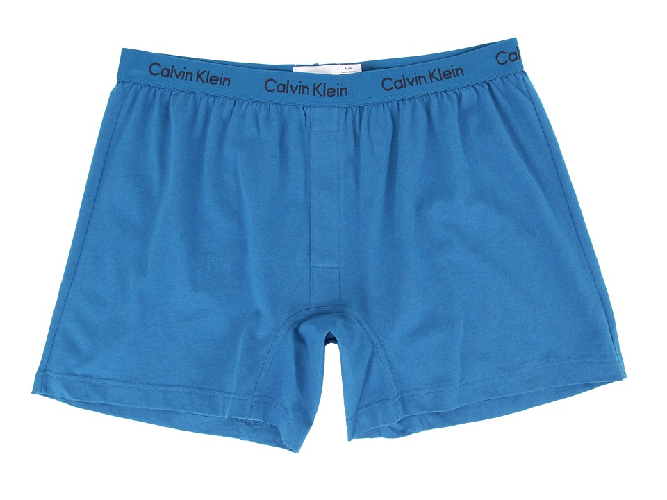 Calvin Klein™ presents a comfy knit boxer in a modern slim fit. Soft cotton jersey boxer boasts a slim fit and shorter length for wear under close-fit pants. Low rise. Signature logo elastic waistband. Snap fly. 100% cotton. Machine wash cold, tumble dry low. Imported.$19