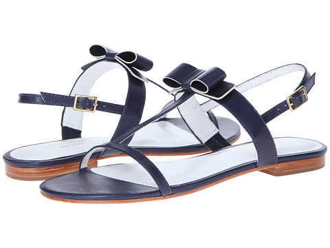 Shop Kate Spade New York online and buy Kate Spade New York Simmon Navy Vacchetta Shoes - Kate Spade New York - Simmon (Navy Vacchetta) - Footwear: Step into fresh femininity with this spring-ready Simmon sandal! ; Leather upper. ; Bow accent at vamp with contrasting trim. ; Open-toe construction with sling back ankle strap and adjustable buckle closure. ; Leather lining and insole. ; Leather sole. ; Made in Brazil. Measurements: ; Heel Height: 1 2 in ; Weight: 6 oz ; Product measurements were taken using size 8.5, width M. Please note that measurements may vary by size.