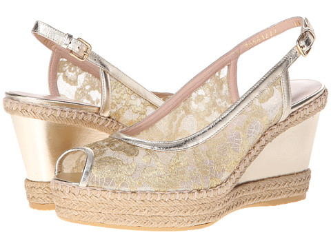 Shop Stuart Weitzman online and buy Stuart Weitzman Tuileries Gold Guipure Lace Shoes - Stuart Weitzman - Tuileries (Gold Guipure Lace) - Footwear: Exude femininity wearing this charming espadrille. ; Lace upper with leather trim. ; Sexy peep toe. ; Adjustable buckle closure. ; Man-made footbed. ; Natural jute trim. ; Leather-covered wedge. ; Rubber sole. ; Made in Spain. Measurements: ; Heel Height: 3 1 2 in ; Weight: 11 oz ; Platform Height: 1 in ; Product measurements were taken using size 8.5, width M. Please note that measurements may vary by size.