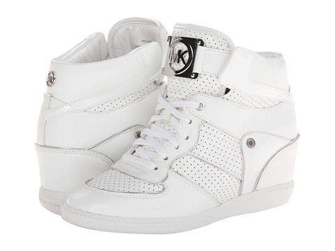 Shop MICHAEL Michael Kors online and buy MICHAEL Michael Kors Nikko High Top Optic White Shoes - MICHAEL Michael Kors - Nikko High Top (Optic White) - Footwear: Elevate your look to urban-cool status with these trendy sneakers! ; Leather and patent upper with metallic trim. ; Lace-up front. ; Polished logo hardware on tongue. ; Perforated and stitched detailing. ; Padded collar. ; Man-made lining. ; Lightly cushioned footbed. ; Hidden wedge. ; Rubber sole. ; Imported. Measurements: ; Weight: 14 oz ; Circumference: 11 in ; Shaft: 5 in ; Product measurements were taken using size 9, width M. Please note that measurements may vary by size.