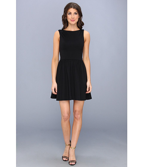 Shop Susana Monaco online and buy Susana Monaco Mila Dress Black Online - Susana Monaco - Mila Dress (Black) - Apparel: Get out and get noticed in this fabulously feminine Susana Monaco dress. ; Contemporary sleeveless dress features a perfectly pleated skirt. ; Soft and stretchy Supplex jersey resists fading and creasing and offers a flattering drape. ; Rounded neckline complements the cutout V-back. ; Slip-on design. ; 84% Supplex nylon, 16% Lycra spandex. ; Machine wash cold, tumble dry low. ; Made in the U.S.A. Measurements: ; Length: 32 in ; Product measurements were taken using size SM. Please note that measurements may vary by size.