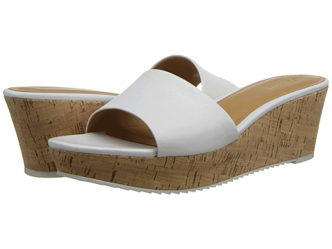 Shop Nine West online and buy Nine West Confetty White Leather Shoes - Nine West - Confetty (White Leather) - Footwear: Keep it simple with these sleek wedge sandals! ; Easy slip-on wear. ; Leather upper. ; Man-made lining. ; Cork platform and wedge heel. ; Man-made sole. ; Imported. Measurements: ; Heel Height: 2 1 2 in ; Weight: 11 oz ; Platform Height: 1 1 4 in ; Product measurements were taken using size 8.5, width M. Please note that measurements may vary by size.