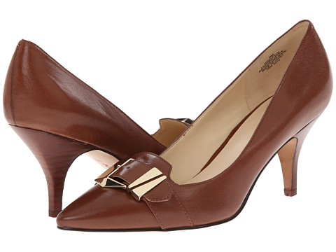 Shop Nine West online and buy Nine West Elexys Dark Brown Leather Shoes - Nine West - Elexys (Dark Brown Leather) - Footwear: These posh pumps are perfect and professional in every way! ; Easy slip-on wear. ; Leather upper with strap and buckle detail at vamp. ; Chic pointed toe. ; Man-made lining. ; Lightly cushioned man-made footbed. ; Stacked heel. ; Man-made sole. ; Imported. Measurements: ; Heel Height: 2 3 4 in ; Weight: 9 oz ; Product measurements were taken using size 10.5, width M. Please note that measurements may vary by size.