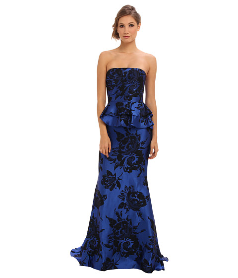 Shop Badgley Mischka online and buy Badgley Mischka Floral Ruffle Royal Black Online - Badgley Mischka - Floral Ruffle (Royal Black) - Apparel: Make the gardens themselves jealous in the Badgley Mischka Floral Ruffle ballgown. ; Strapless, A-line dress flaunts a ruffled peplum accent that trails down the back center-seam. ; Satin gown is printed throughout with a rose pattern. ; Inset corset with flexible boning and silicone taping. ; Concealed zip closure in the back. ; Floor-length hemline with sweep train. ; Lined. ; 44% acetate, 22% viscose, 18% cotton, 16% nylon; Lining: 100% polyester. ; Dry clean only. ; Imported. Measurements: ; Length: 65 in ; Product measurements were taken using size 4. Please note that measurements may vary by size.
