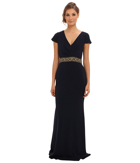 Shop Badgley Mischka online and buy Badgley Mischka Cap Sleeve Gown Navy Online - Badgley Mischka - Cap Sleeve Gown (Navy) - Apparel: An elegant evening awaits you in the Badgley Mischka Cap Sleeve Gown. ; Drapey A-line ballgown features an exquisitely beaded empire waistline. ; Surplice neckline with cap sleeves. ; Concealed zip closure in back. ; Godet in back creates a dramatic sweep train at the floor-length hem. ; Lined. ; 98% polyester, 2% spandex; Lining: 100% polyester. ; Spot clean only. ; Spot clean only. ; Imported. Measurements: ; Length: 67 in ; Product measurements were taken using size 4. Please note that measurements may vary by size.