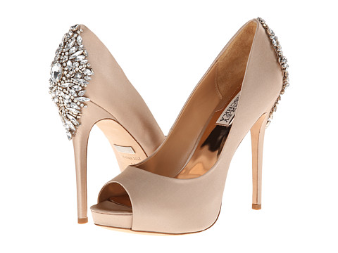 Shop Badgley Mischka online and buy Badgley Mischka Kiara Latte Satin Footwear - Zappos.com is proud to offer the Badgley Mischka - Kiara (Latte Satin) - Footwear: Make a splash with these stunning pumps! ; Easy slip-on wear. ; Satin upper with rhinestone-encrusted heel cup. ; Metallic leather lining. ; Cushioned leather footbed. ; Wrapped platform and heel. ; Man-made sole. ; Imported. Measurements: ; Heel Height: 4 3 4 in ; Weight: 11 oz ; Platform Height: 1 in ; Product measurements were taken using size 8.5, width M. Please note that measurements may vary by size.