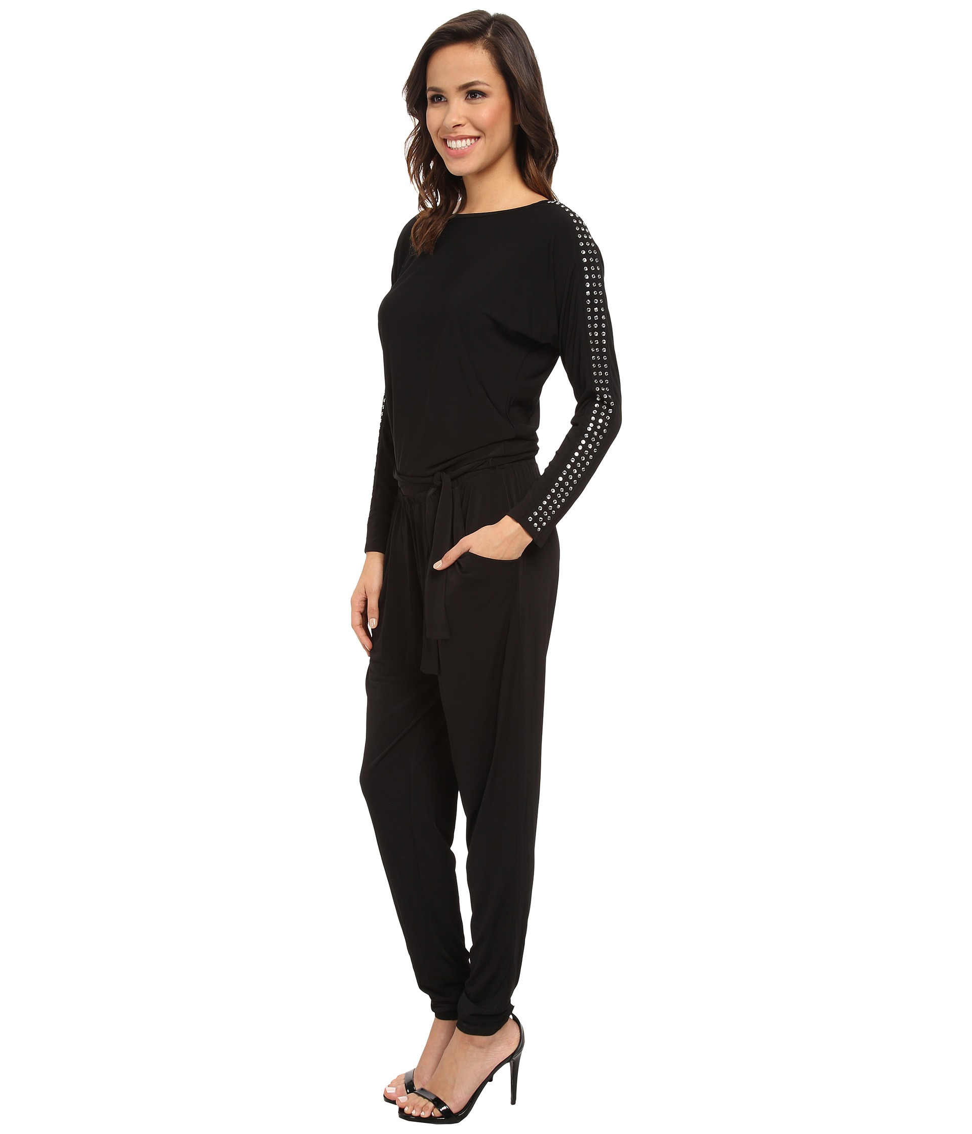 Michael Kors Black Jumpsuit, Michael Kors Wrap Front Jumpsuit, Size XS, Black MK It has a very feminine, wrap neckline with a snap. It will make a perfect composition with high heels and leather jacket.