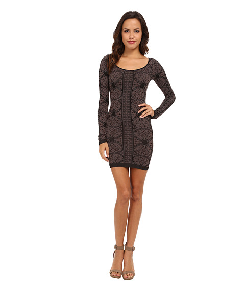 Shop Free People online and buy Free People Jacquard Seamless Bodycon Slip Black Combo Online - Free People - Jacquard Seamless Bodycon Slip (Black Combo) - Apparel: Stretch jersey dress flaunts a curve-hugging silhouette and seamless construction. ; Feminine jacquard design. ; Wide scoop neckline and long sleeves. ; Pull-on design. ; Straight hemline falls above the knee. ; 92% nylon, 8% spandex. ; Machine wash cold, dry flat. ; Made in the U.S.A. and Imported. Measurements: ; Length: 30 in ; Product measurements were taken using size XS/SM (Women's 0-6). Please note that measurements may vary by size.