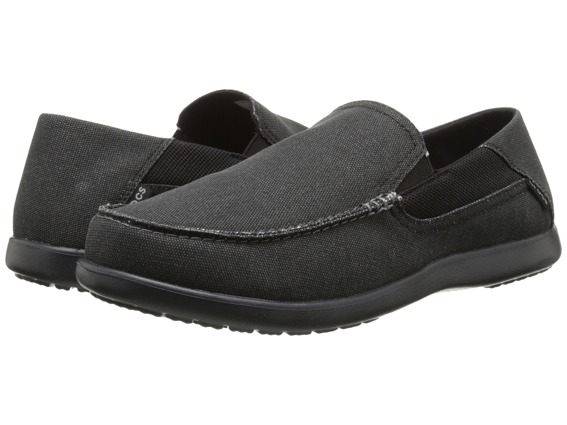 Enjoy Crocs™ comfort in a traditionally-styled canvas loafer with the Santa Cruz 2 Luxe Slip-On Shoes for Men. Proof that loafers can be truly comfortable, the Santa Cruz 2 Luxe features drop-in croslite™ material and memory foam footbeds for the same ergonomic support and comfort as a Crocs clog in a casual beach shoe style.