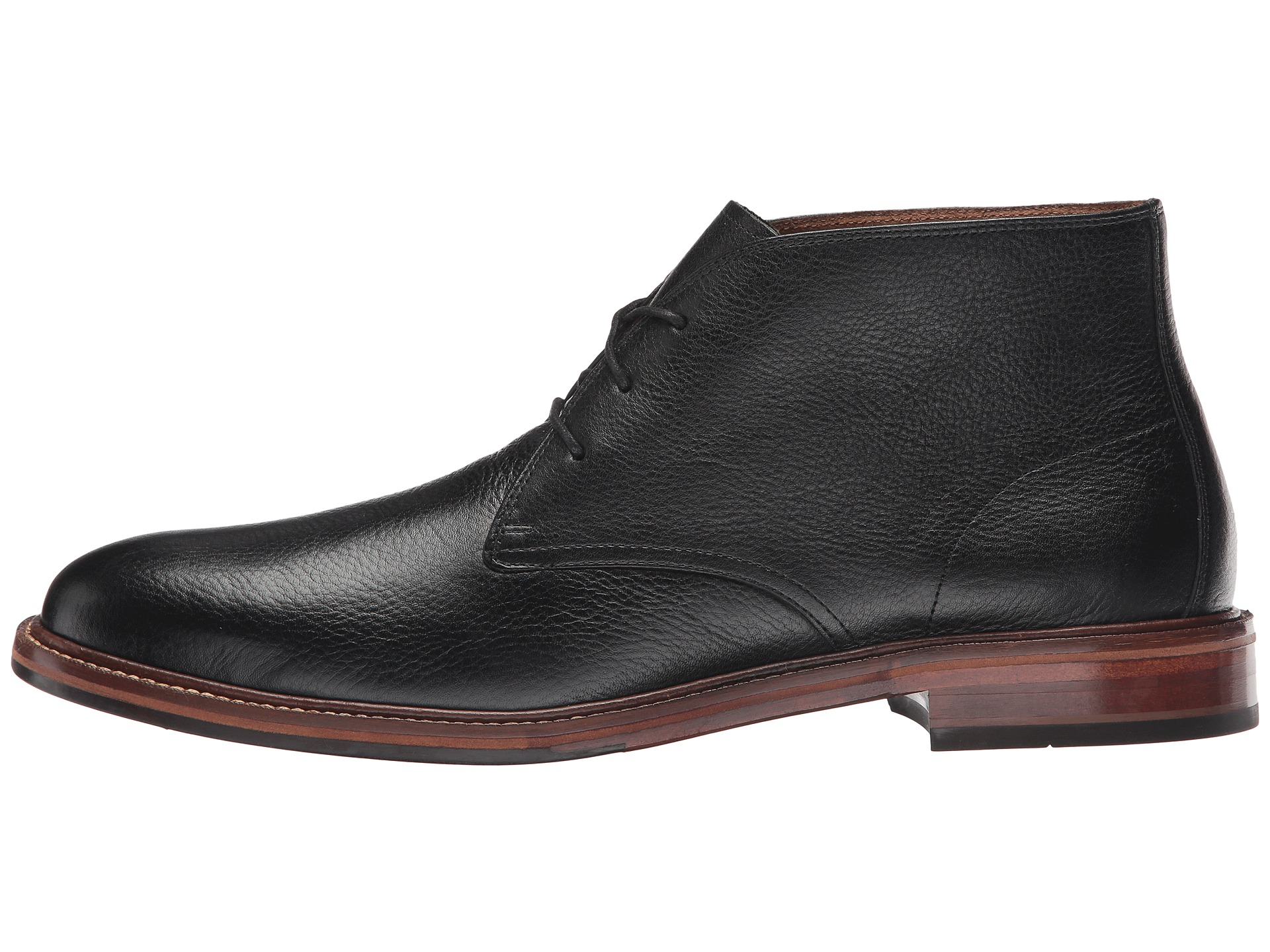 About Cole Haan Dustin Wingtip II Shoes - Leather (For Men) Closeouts. Boasting classic wingtip styling, allover brogue trim and a rich, burnished leather, Cole Haan's Dustin Wingtip II shoes are the quintessential oxfords every refined gentleman should own.