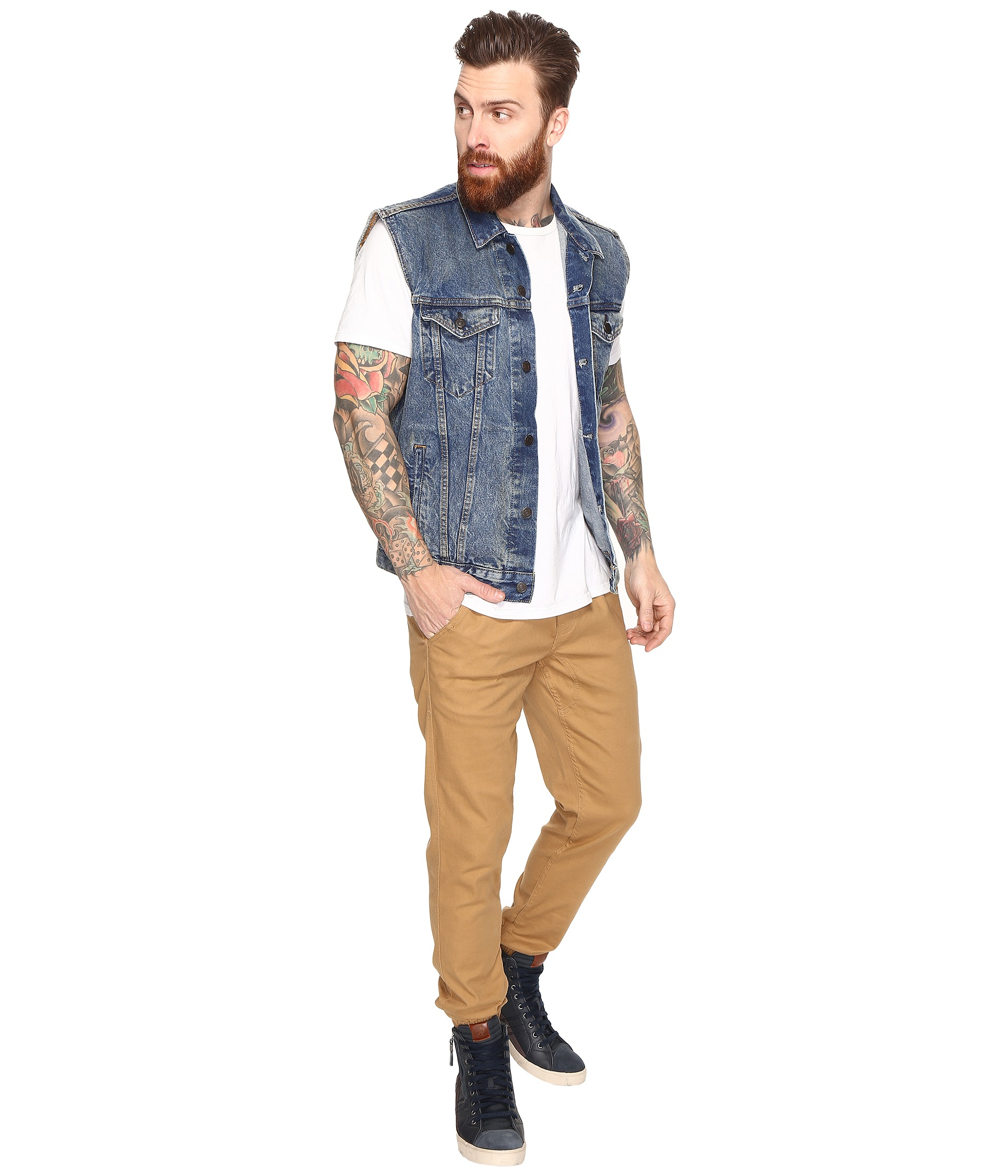The trucker jacket has been an American fashion staple for well over years. What started as a workwear necessity has evolved slowly into a fashion staple that's defined the look of cowboys, punks, surfers, and all-American attire over the decades.