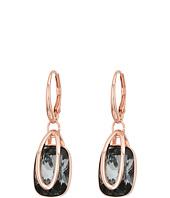 Swarovski - Holding Pierced Earrings